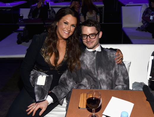 Founder of The Art of Elysium, Jennifer Howell (L) and actor Elijah Wood